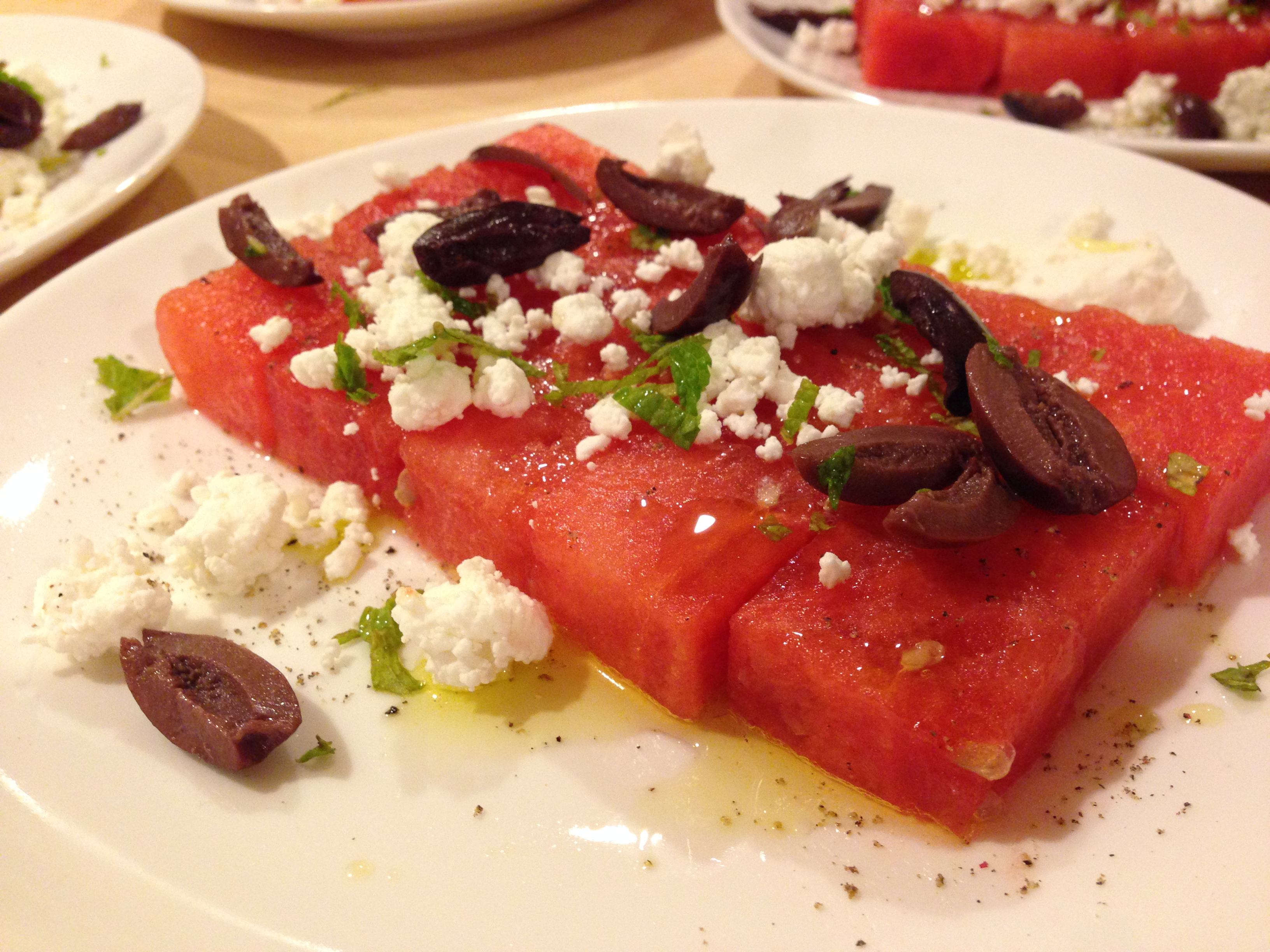 Easy watermelon salad with goat cheese, kalamata olives mint and lime juice